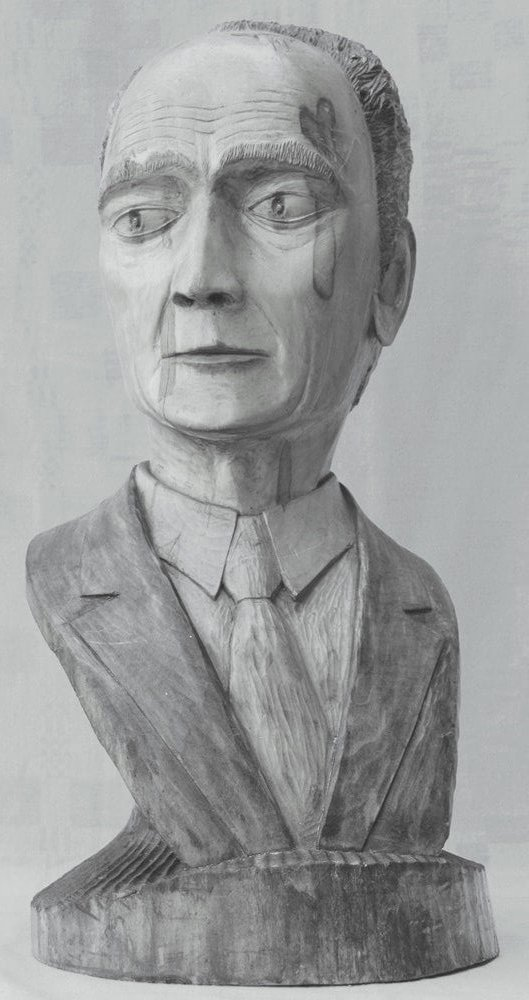Biustas (medinis, 'A. Petrauskas', vyras su kostiumu, 1986 m., h - 51 cm.).