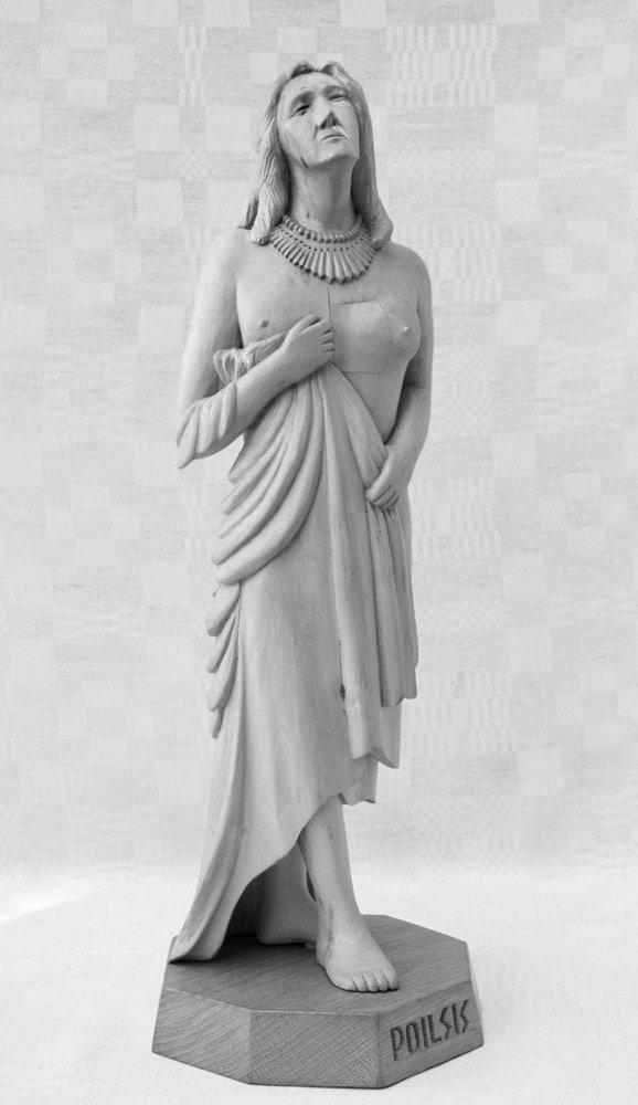 Statulėlė (medinė, 'Poilsis', audeklu prisidengusios pusnuogės moters figūra, 2006 m., h - 53 cm.)