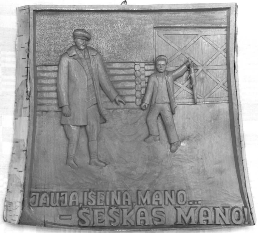 Reljefas (medinis, 'Šeškas mano', pagal Baltušio knygą. Vaizduoja piemenėlį su šešku, yra užrašas: 'Jauja išeina mano, tai ir šeškas mano', 1993 m., 38 x 34 cm.).